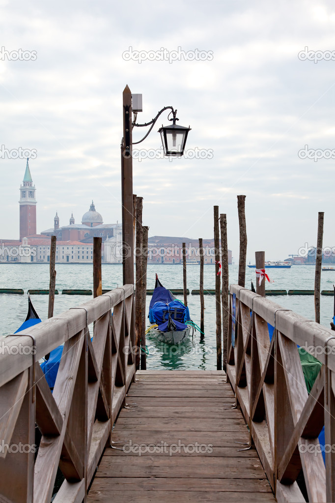 Gondola at the end of the bridge with blue cover