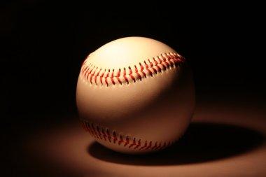 White baseball against dark background stock vector