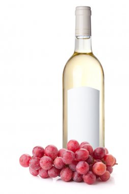 White wine in bottle and red grapes