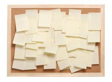 A lot of note papers on a cork board