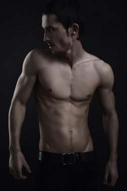 Beautiful athletic caucasian man on dark background