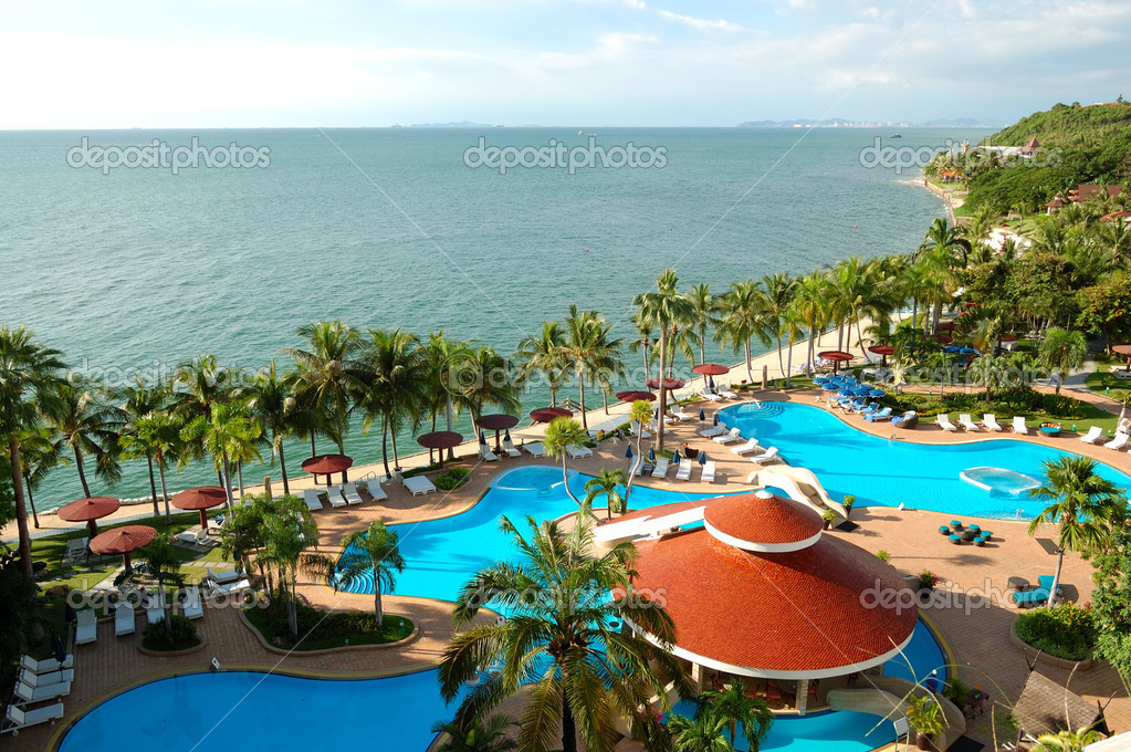 Swimming pools and bar at the beach of luxury hotel, Pattaya, Th