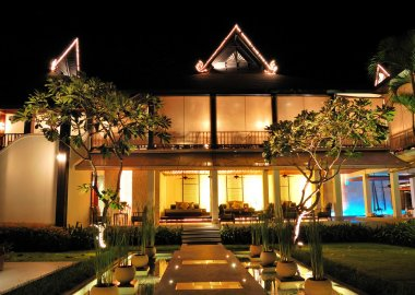 Lounge area and bar of luxury hotel in night illumination, Samui