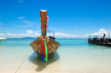 Traditional Thai style boat on turquoise water at the beach of P