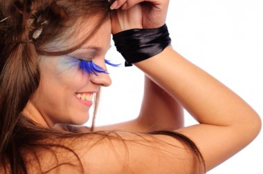 Woman with fashion make-up and black ribbon on carpi