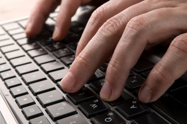 Hands on keyboard of computer