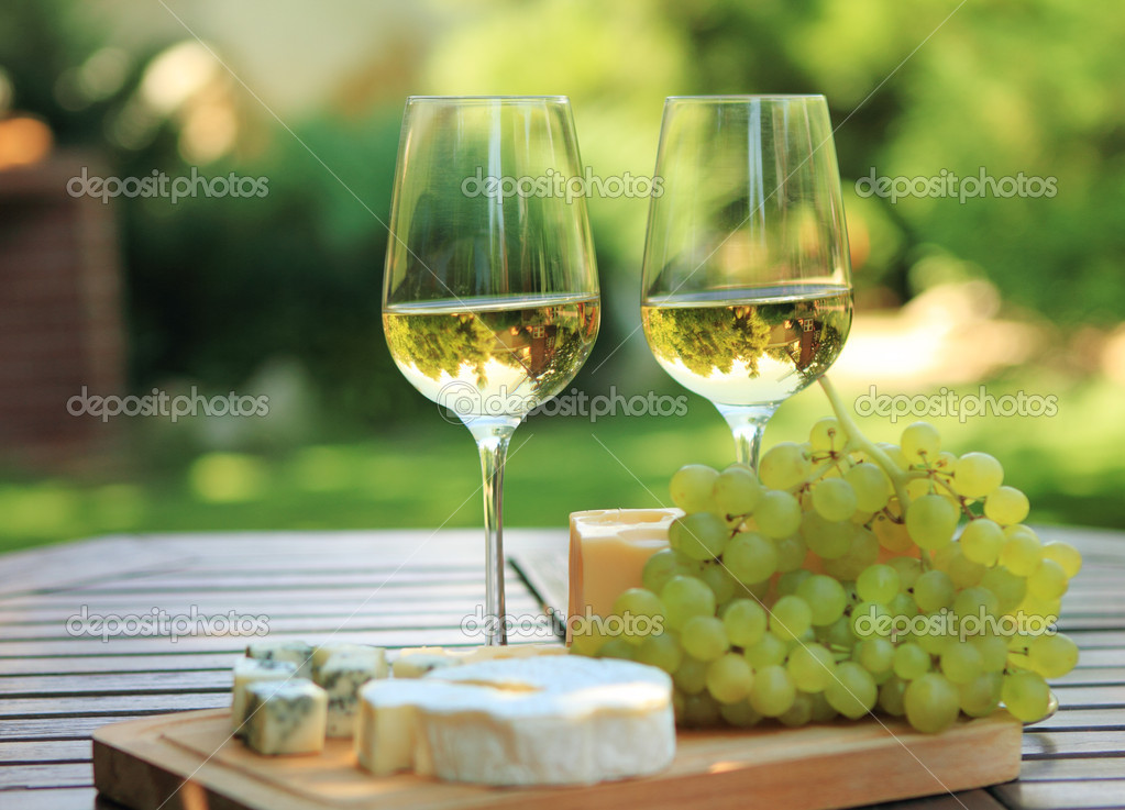 Various sorts of cheese and white wine