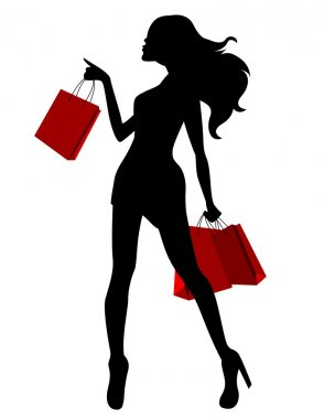 Silhouette of young woman carring bags