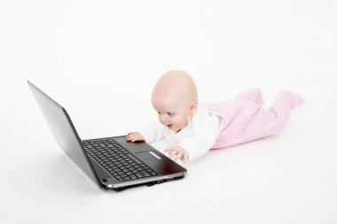 Baby playing on the computer