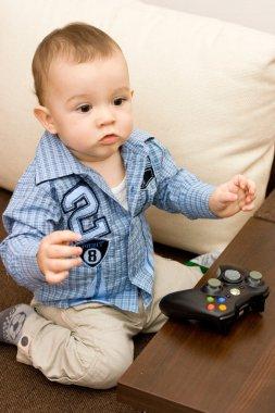 Caucasian baby and joystick