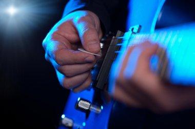 Closeup of guitarist hands