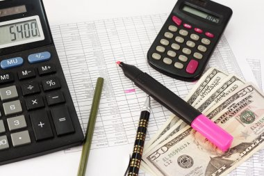 Account statements, credit calculations, calculators, pen and dollar bills