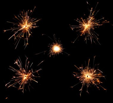 Collection of burning christmas sparklers isolated on black background stock vector