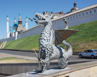 Sculpture of dragon on a background a mosque in city Kazan
