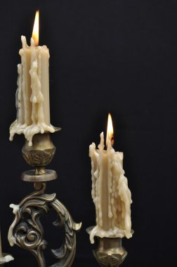 Two melting candles