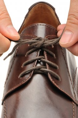 To fasten bootlace on shoes