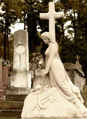 Tombstone women with a cross