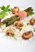 Organic risotto rice with asparagus and parsley