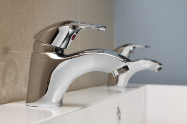 Faucet and sink - modern bathroom close-up