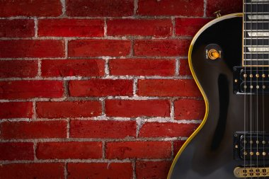 Guitar on grunge background - music