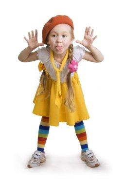 Fun little girl grimacing.