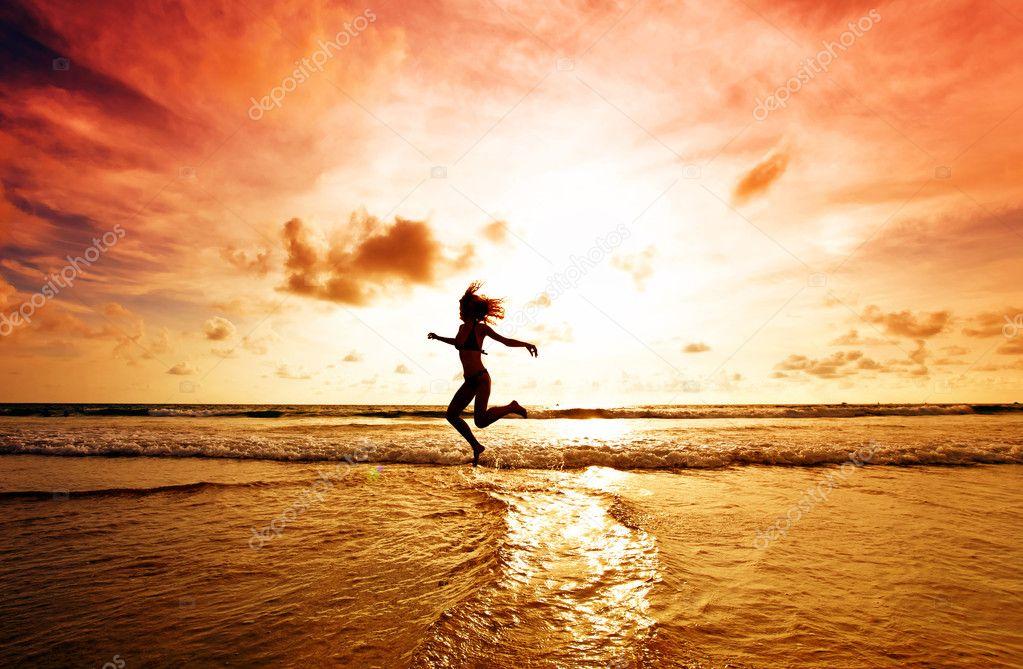 Dancing girl on a tropical beach
