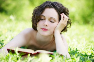 Young woman reading outdoors