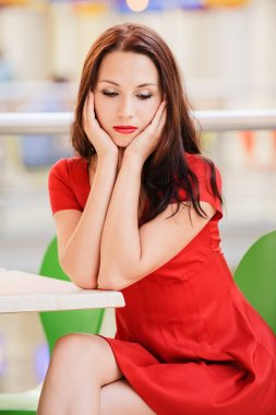 Dark-haired woman in red dress