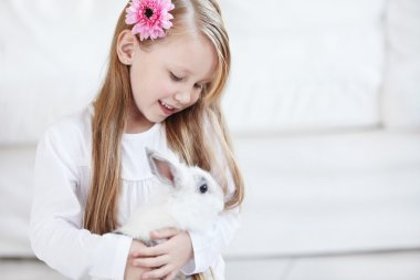 Little girl and white rabbit