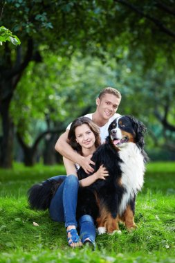 The happy couple with a dog