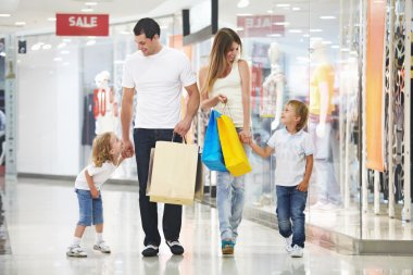 Young family with two children in the store