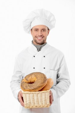 Cook holds a basket of bread