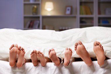 Feet under a blanket