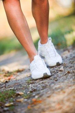 Woman walking trail