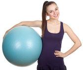 Mladá žena a big blue ball
