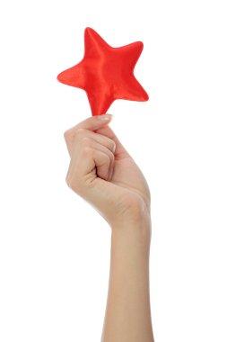 Hand holding christmas star