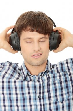 Man with headphones listening to music stock vector