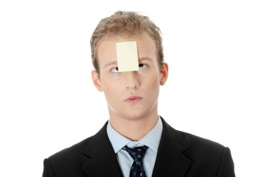 Businessman with memo stick message notes on forehead