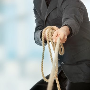 Businessman pulling on a rope