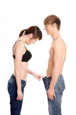 Girl looking in mens pants