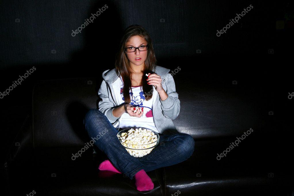 Beautiful girl watching new movie