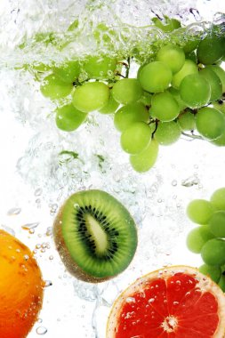 Fruits dropped into water