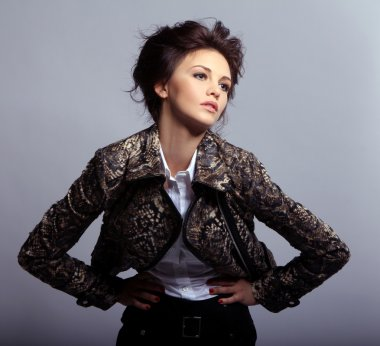 Portrait of attractive woman in leather jacket