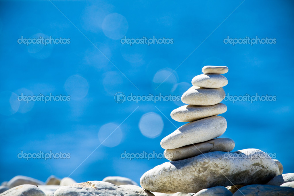 Stones stack over blue sea