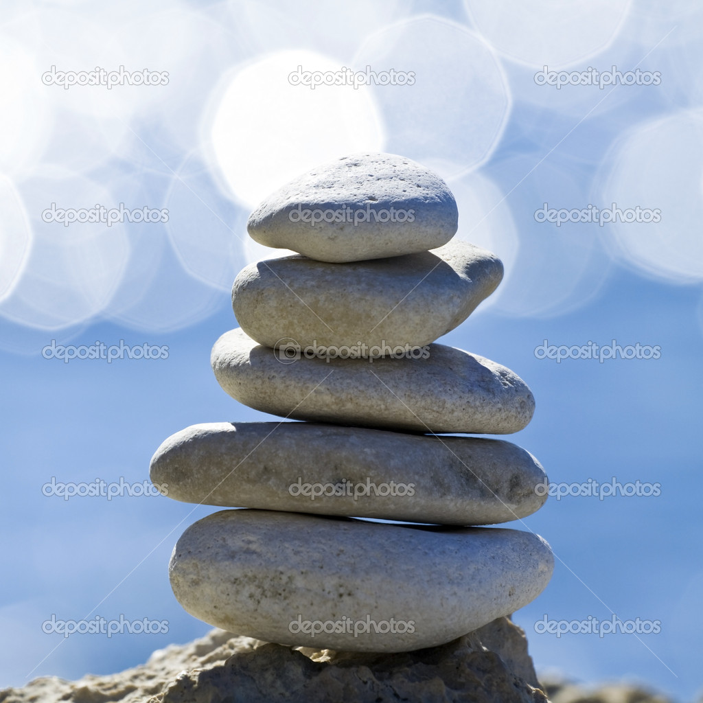 Pebbles stack over blurred sea