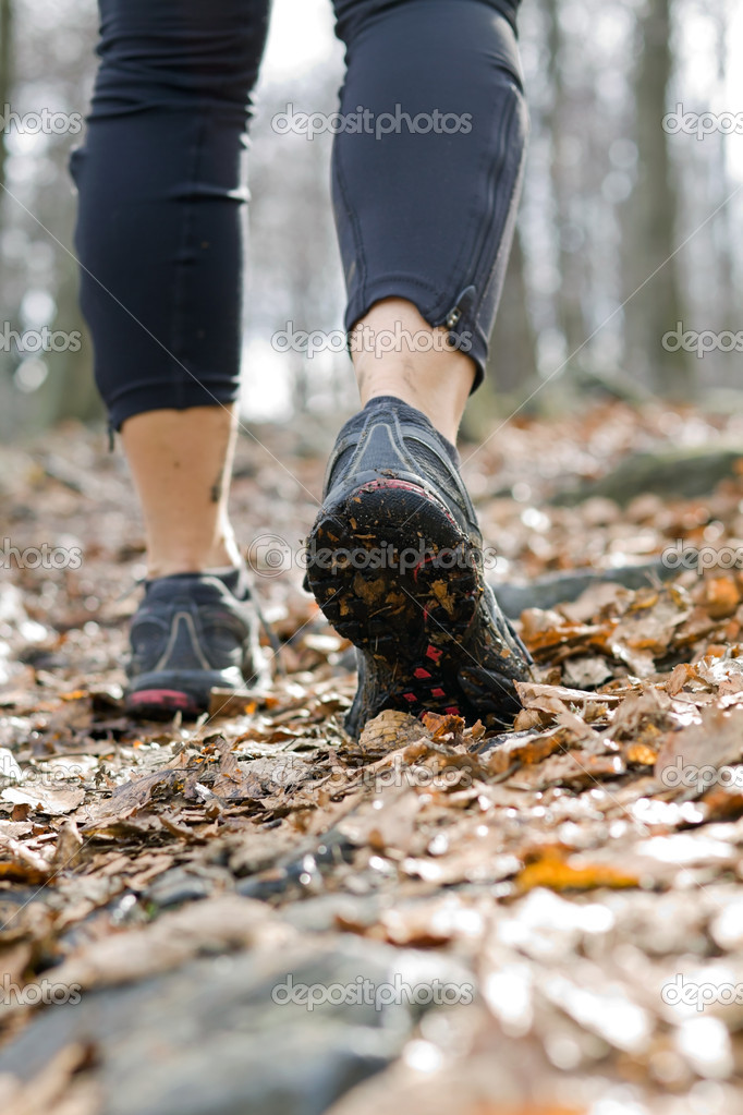 Hiking in autumn forest, walking legs