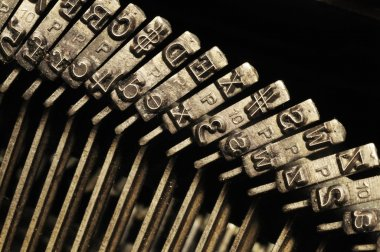 Close-up of old typewriter letter and symbol keys