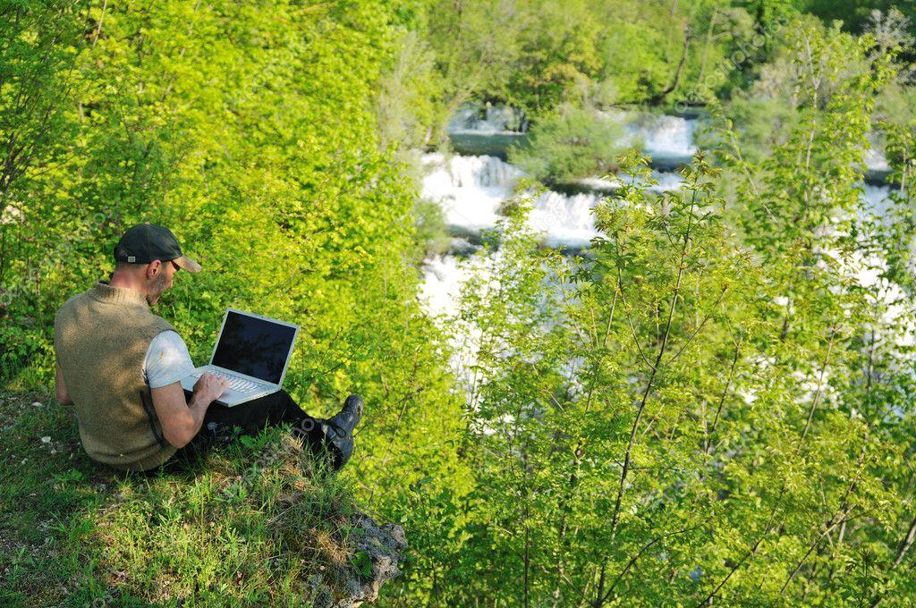 Man outdoor laptop