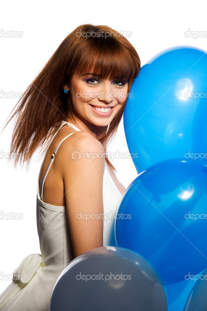 Smiling woman holding ballons