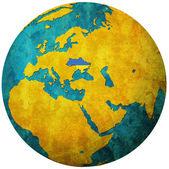 Ukraine flag on globe map